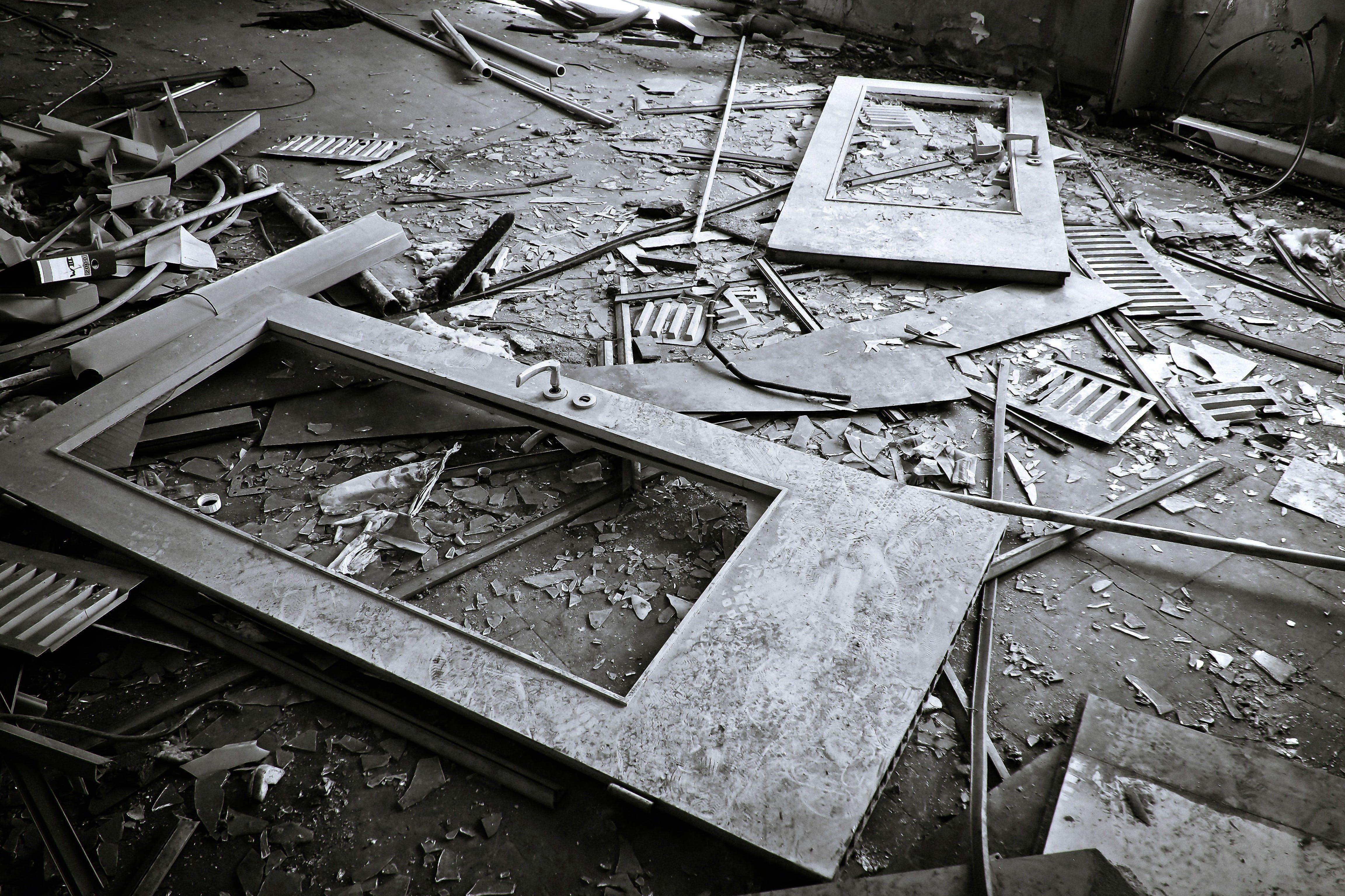 Grayscale Photography of Broken Doors on Floor