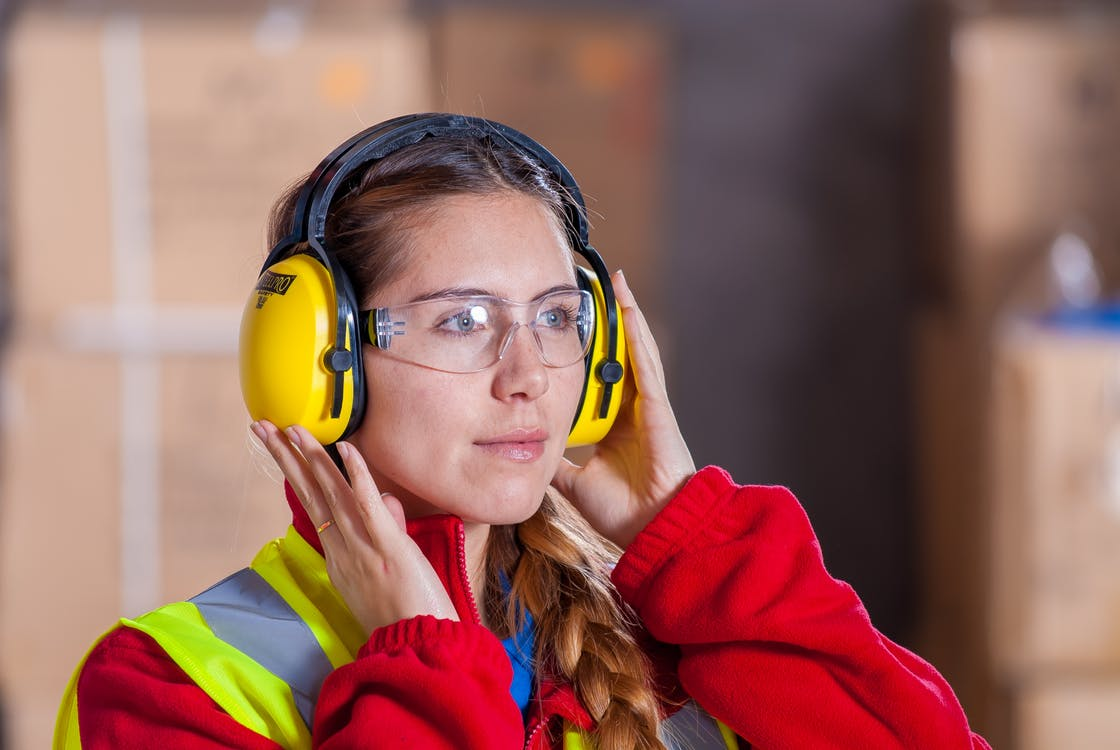Woman Wearing Yellow Ear Pads and Goggles