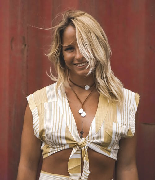 Photo of Woman Wearing White And Yellow Top