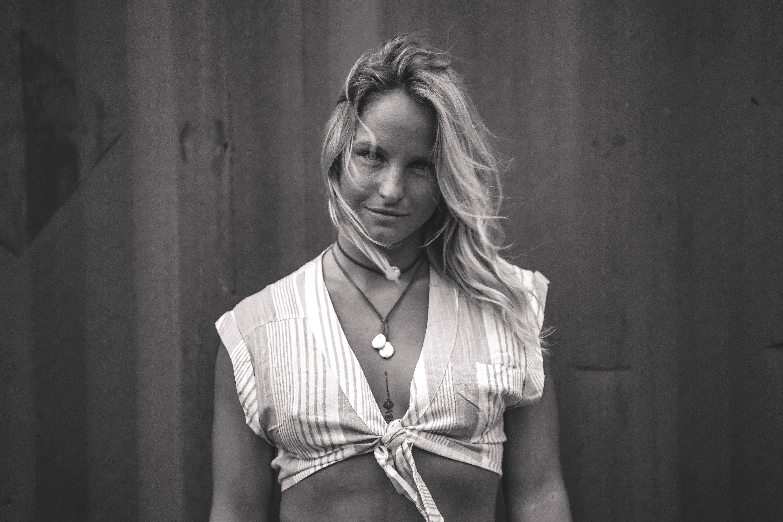 Monochrome Photo of Woman Wearing Crop Top