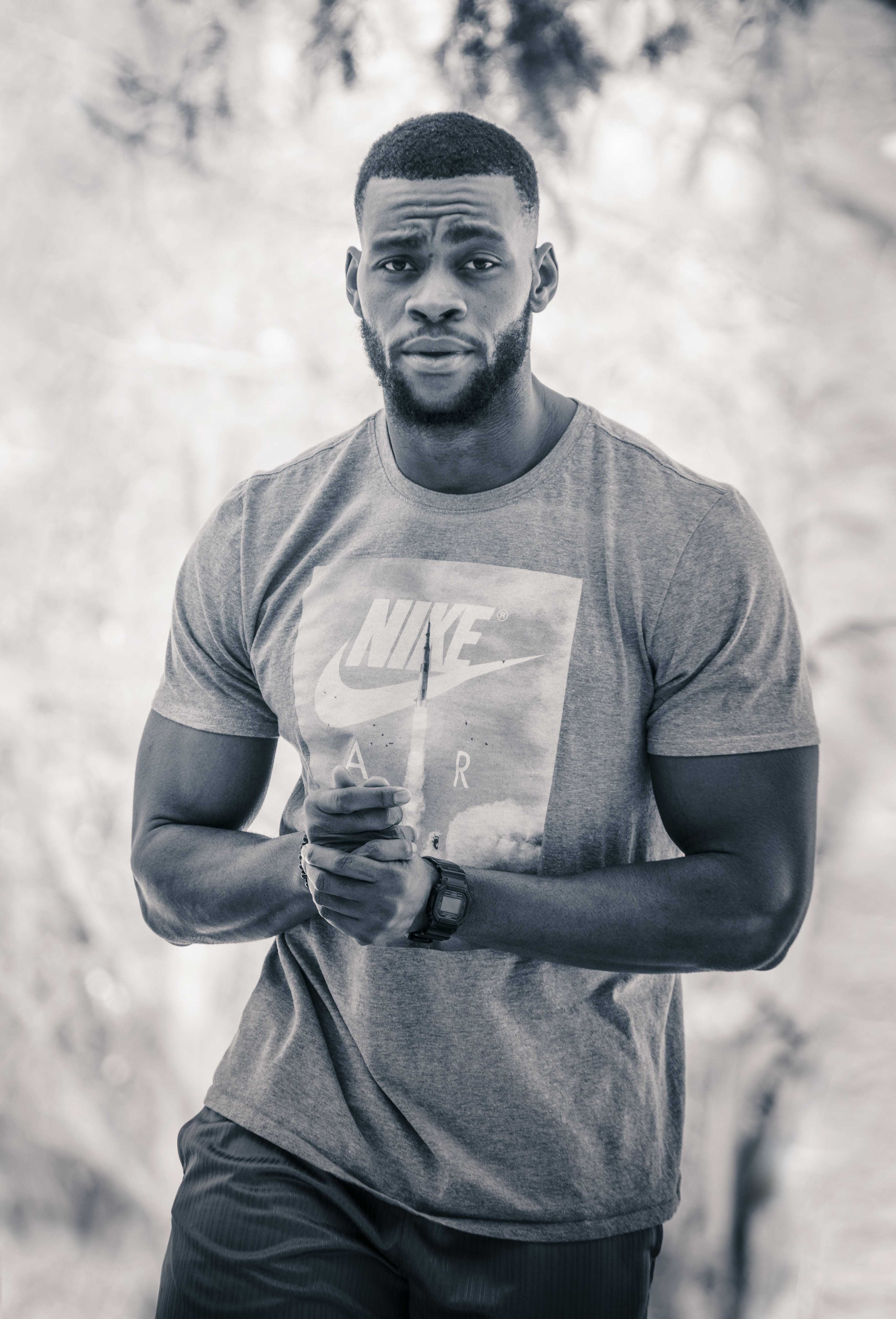 Grayscale Photo Of Man In Nike Crew Neck T-shirt