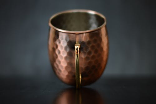 Brass-colored Cup on Selective Focus Photography