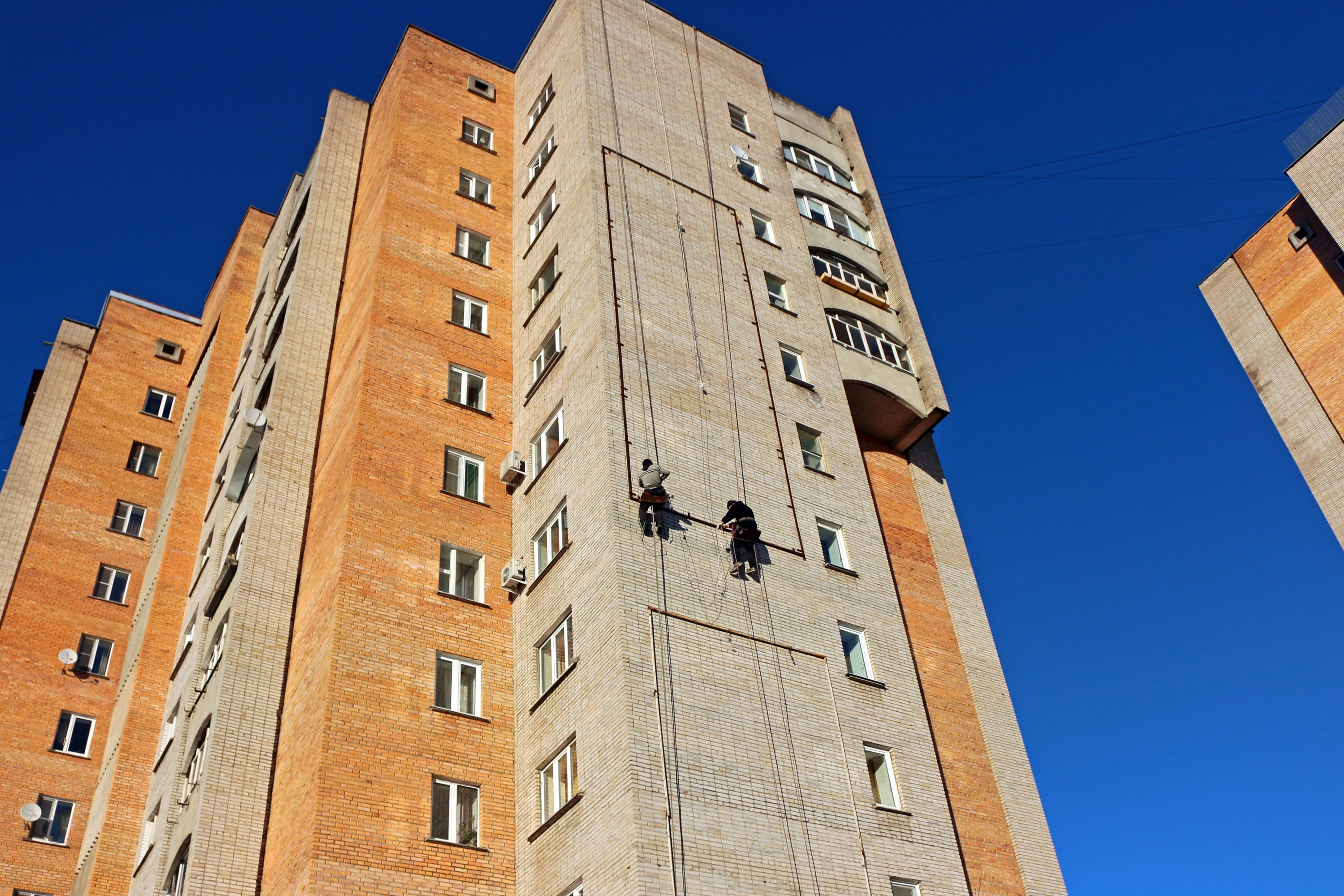 Person Hanging on a High Rise Building