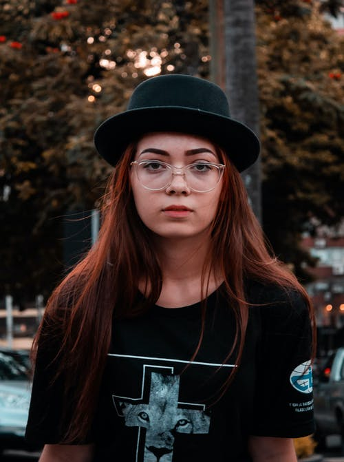 Photo of Woman Wearing Black Fedora
