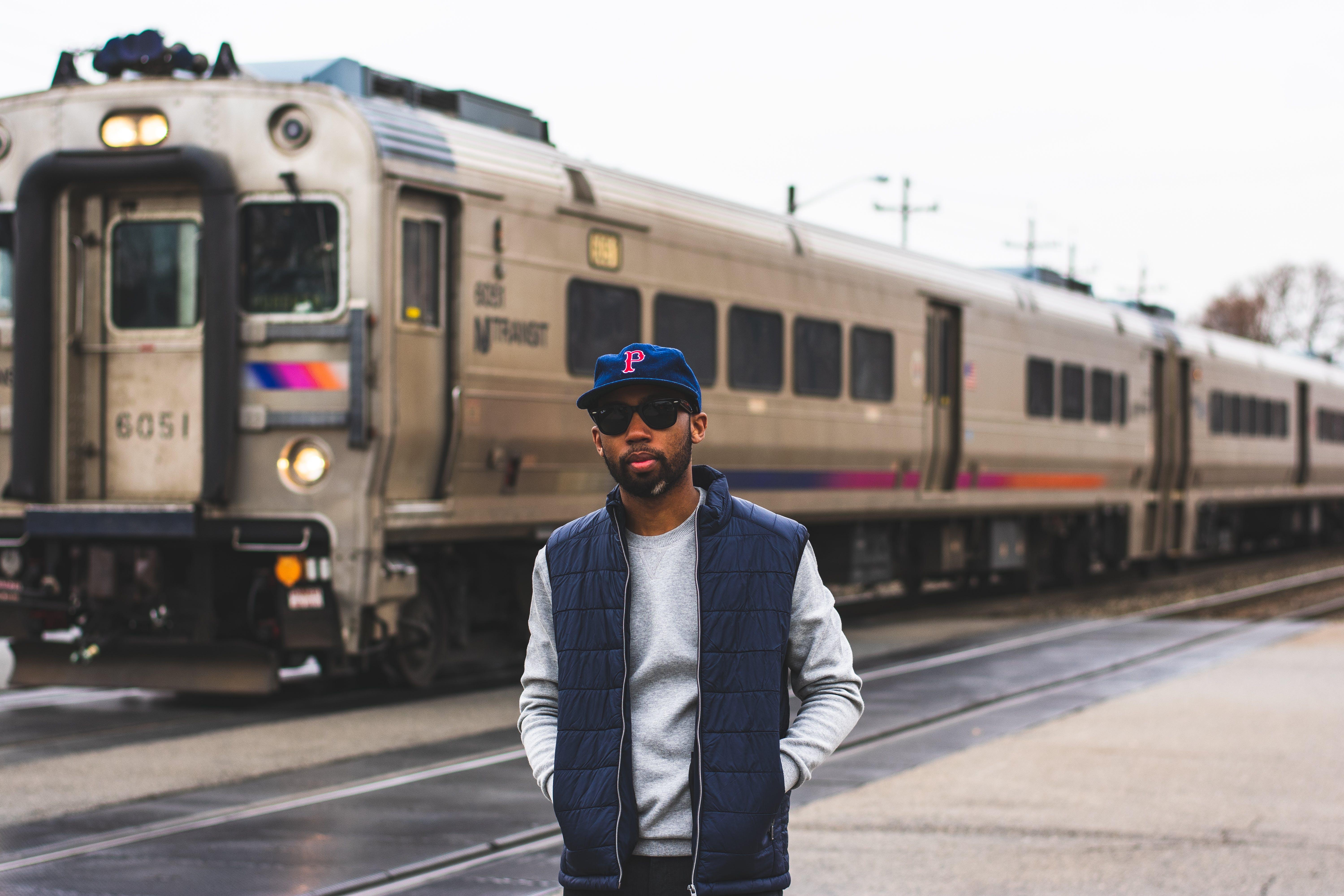Man Standing Near Train