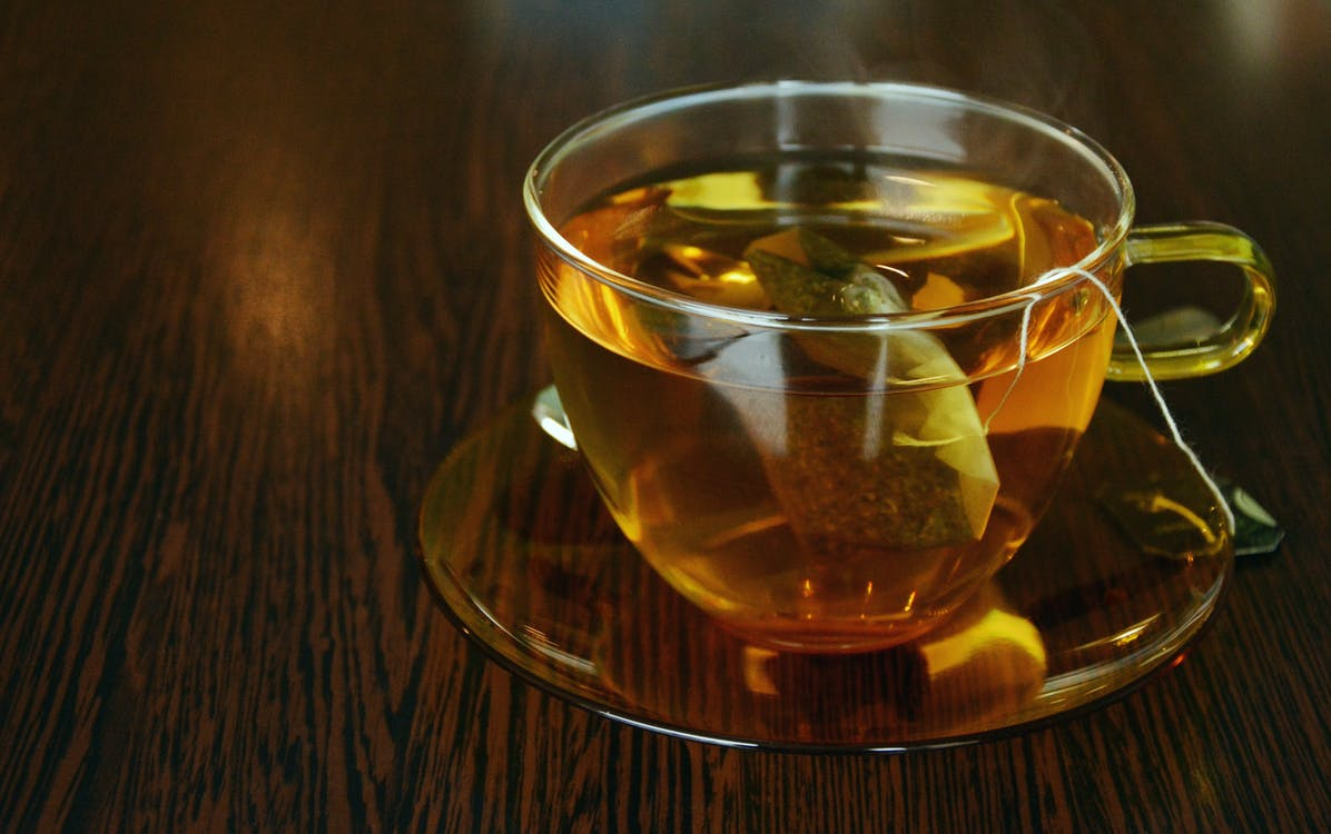 Clear Glass Teacup Filled With Tea