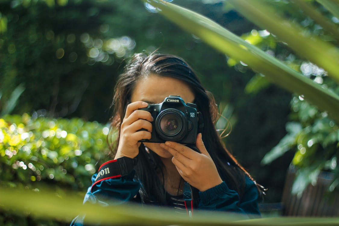 Woman Using A Dlsr Camera