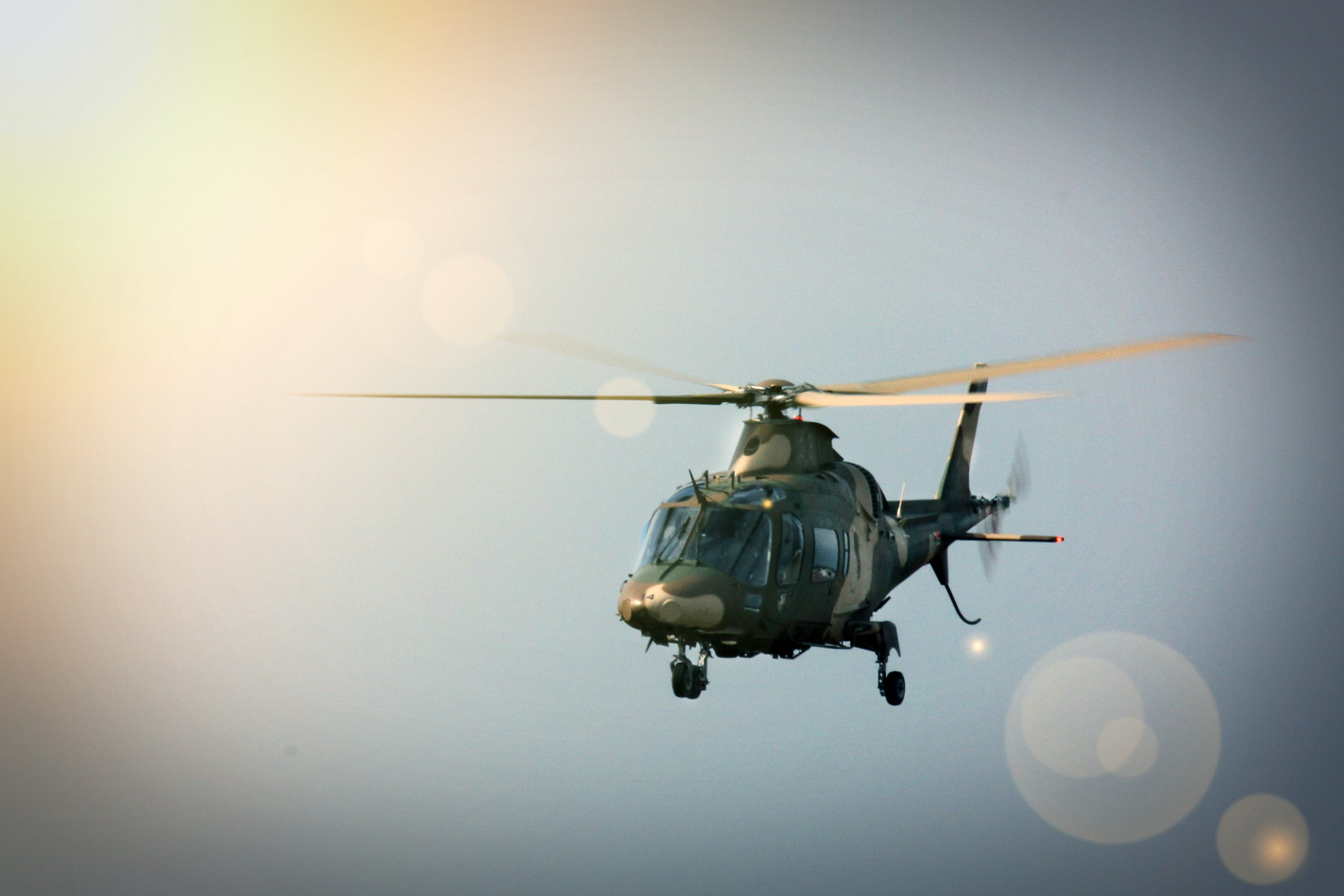 Free stock photo of helicopter, sunflair
