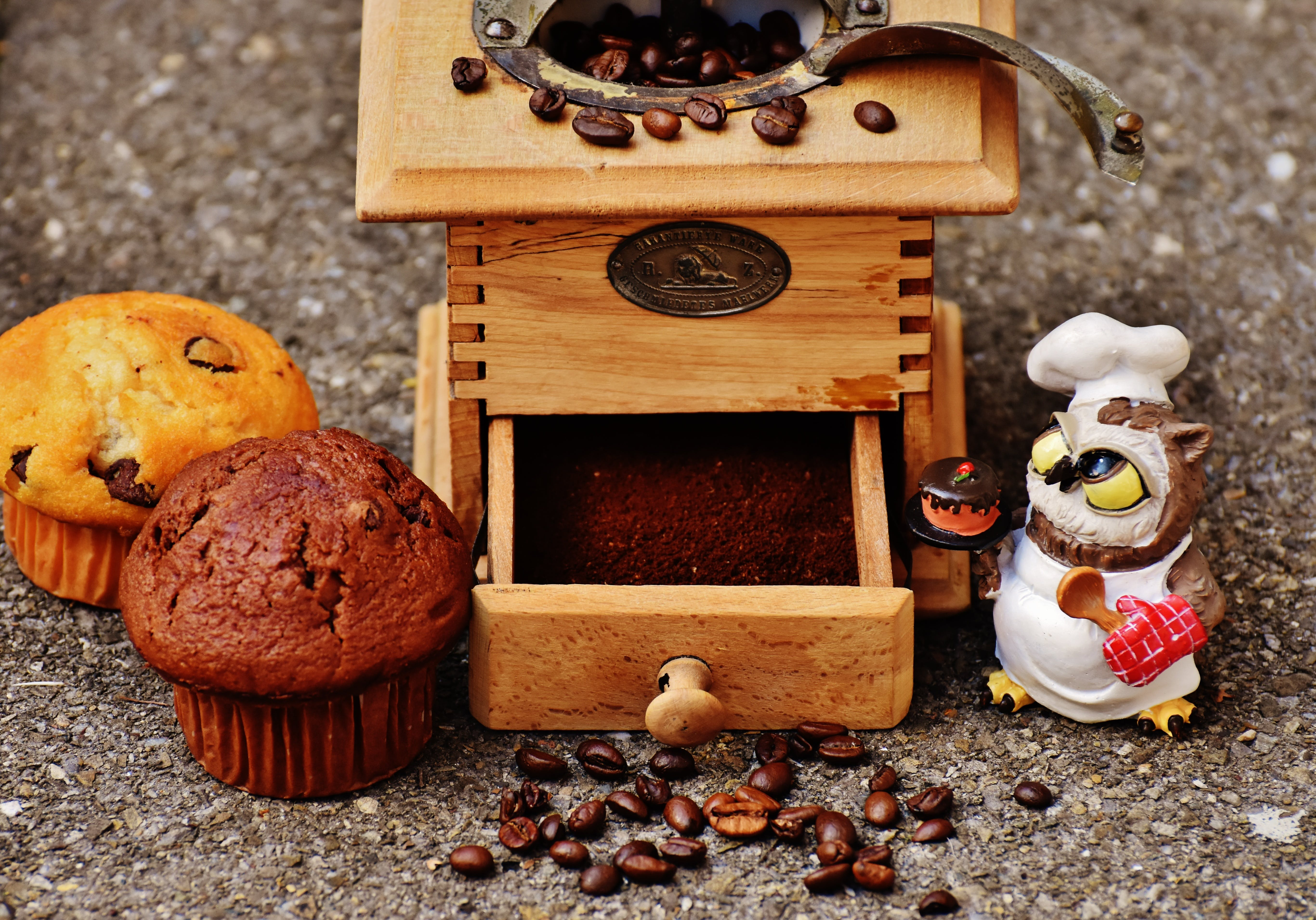 Brown Wooden Coffee Bean Grinder and Two Muffins