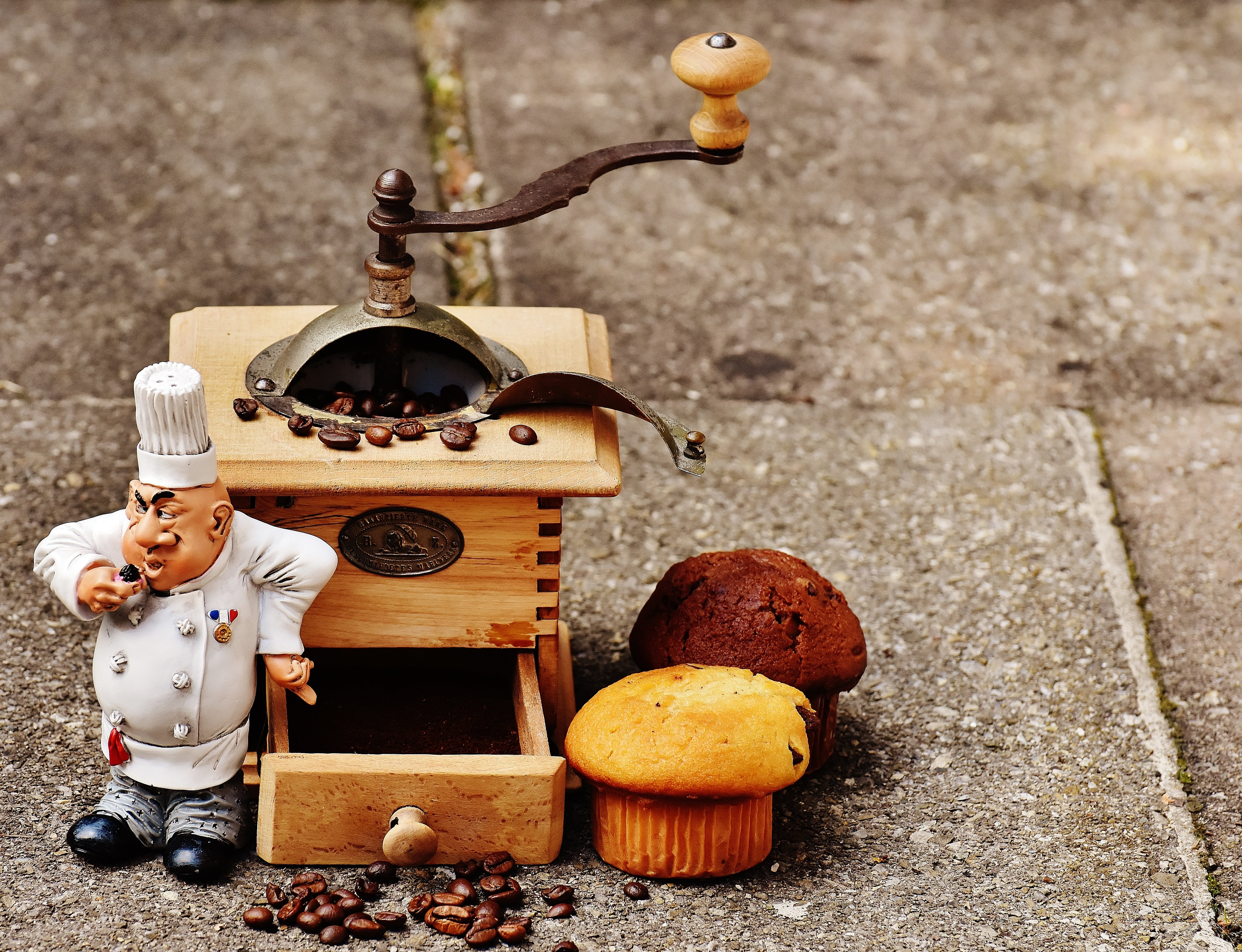 Miniature Chef Figurine on Gray Surface