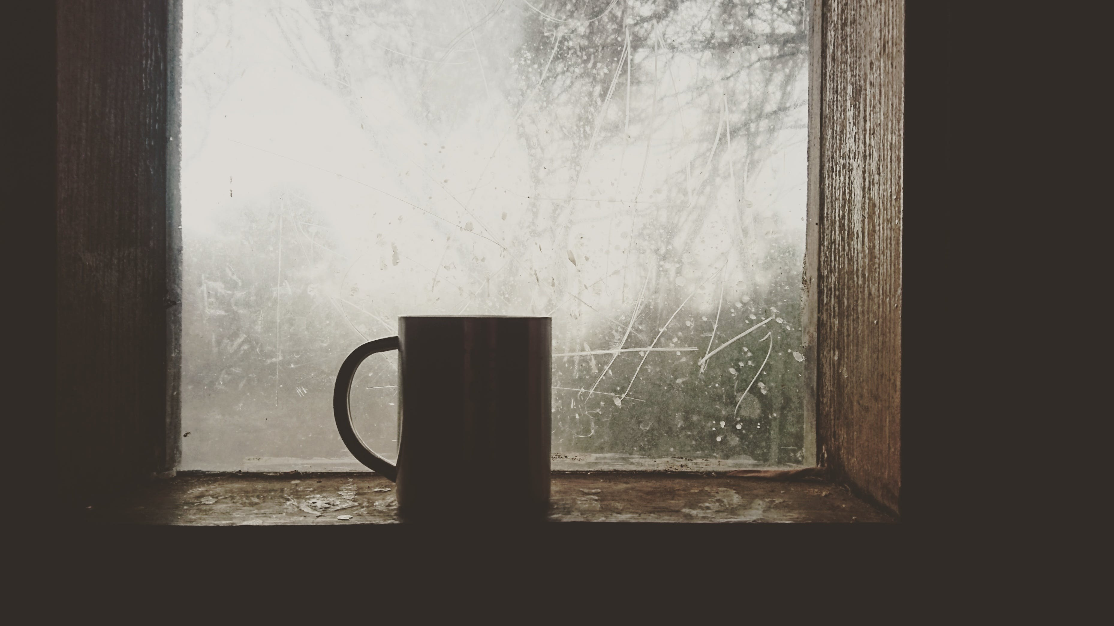 Silhouette of Mug Near Windowpane
