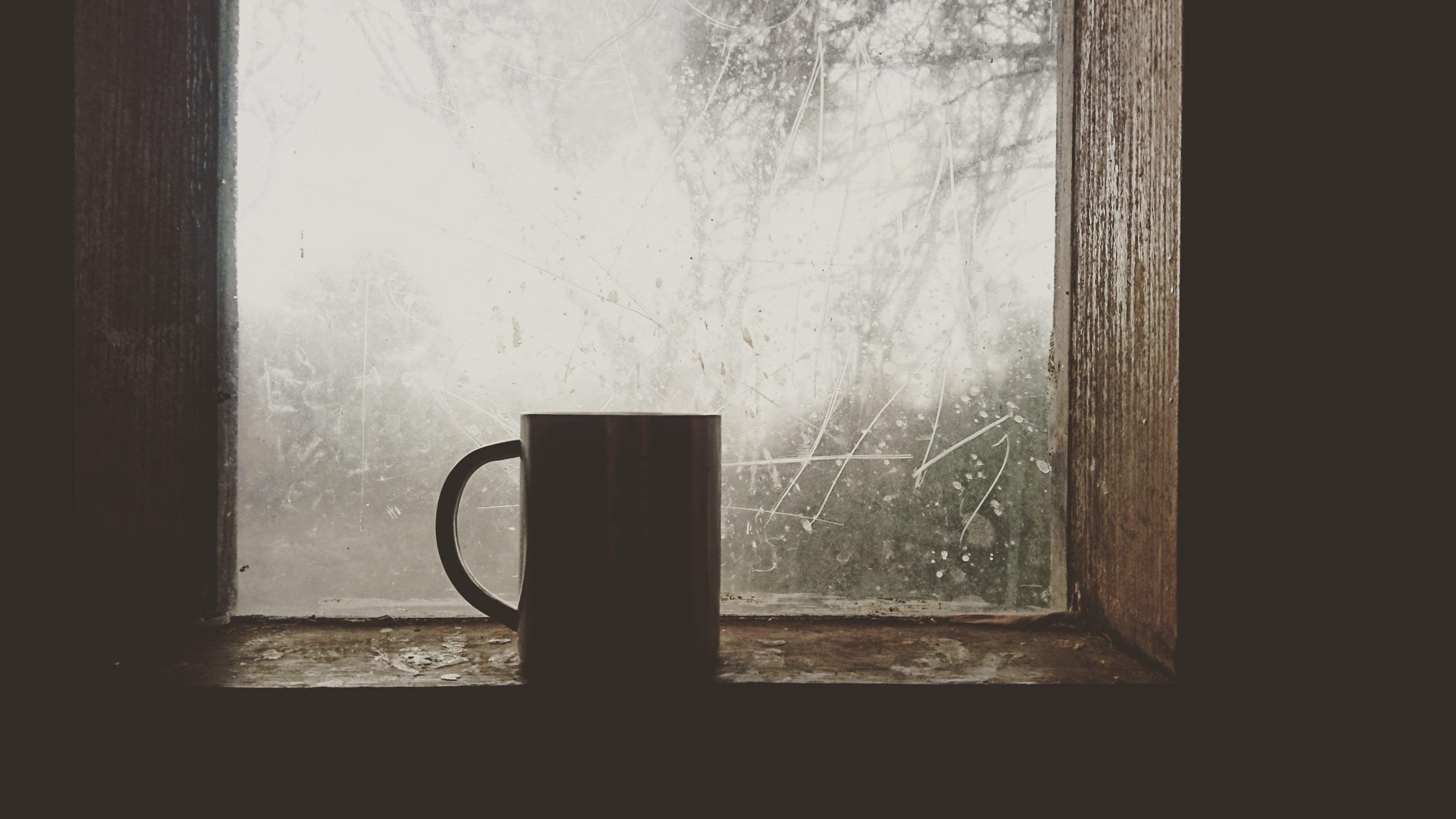 Silhouette of Mug Near Windowpane
