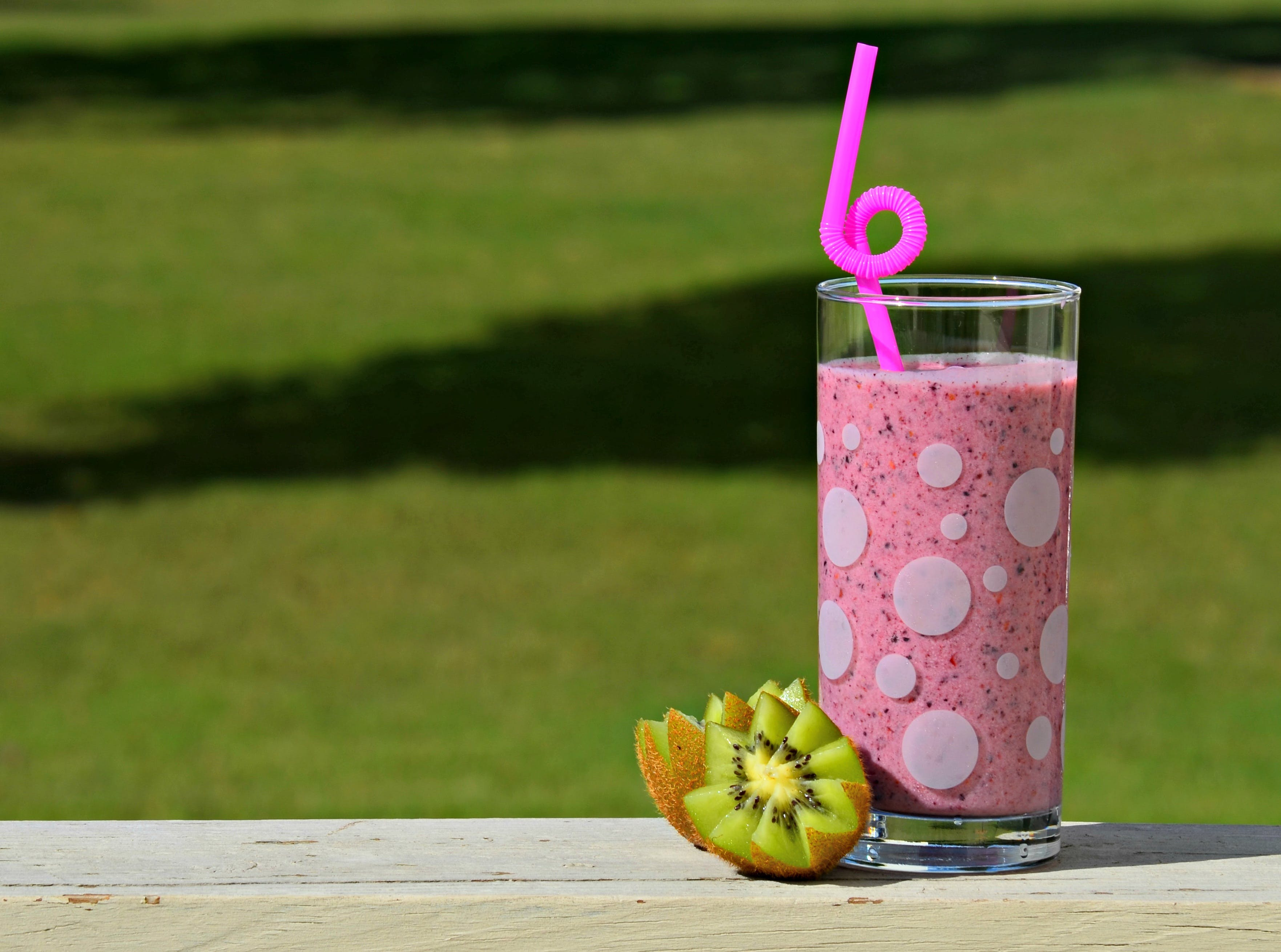 Clear Highball Glass Filled With Pink Liquid