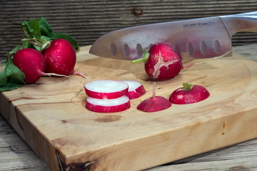 Sliced Radish on Brown Wooden Chopping Board