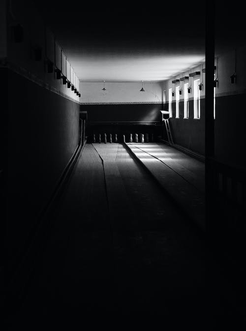 Grayscale Photography of Bowling Alley