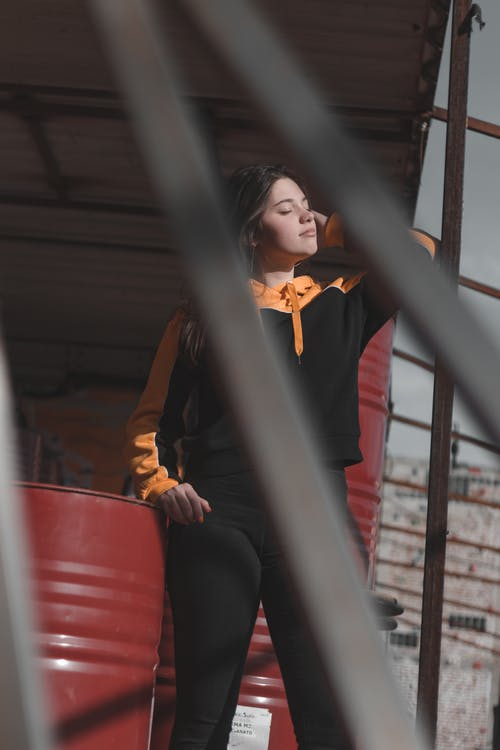 Woman Wearing Black and Orange Jacket