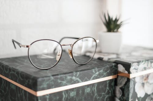 Gray-framed Eyeglasses on Black Surface