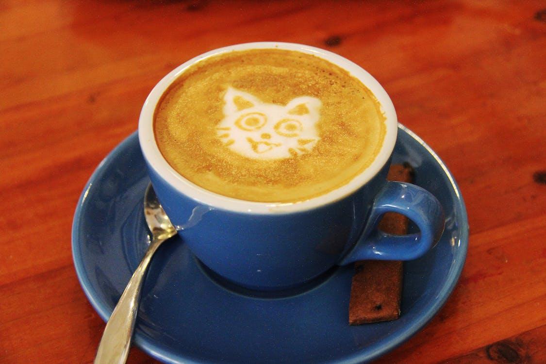 Blue Mug and Saucer With Coffee