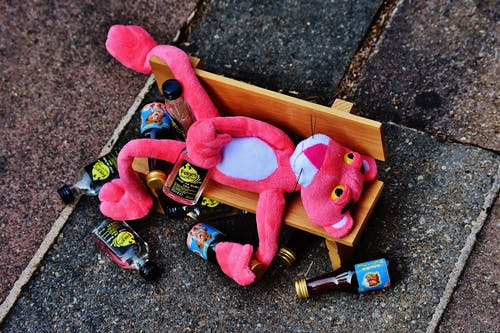 Pink Panther Plush Toy on Brown Bench Miniature