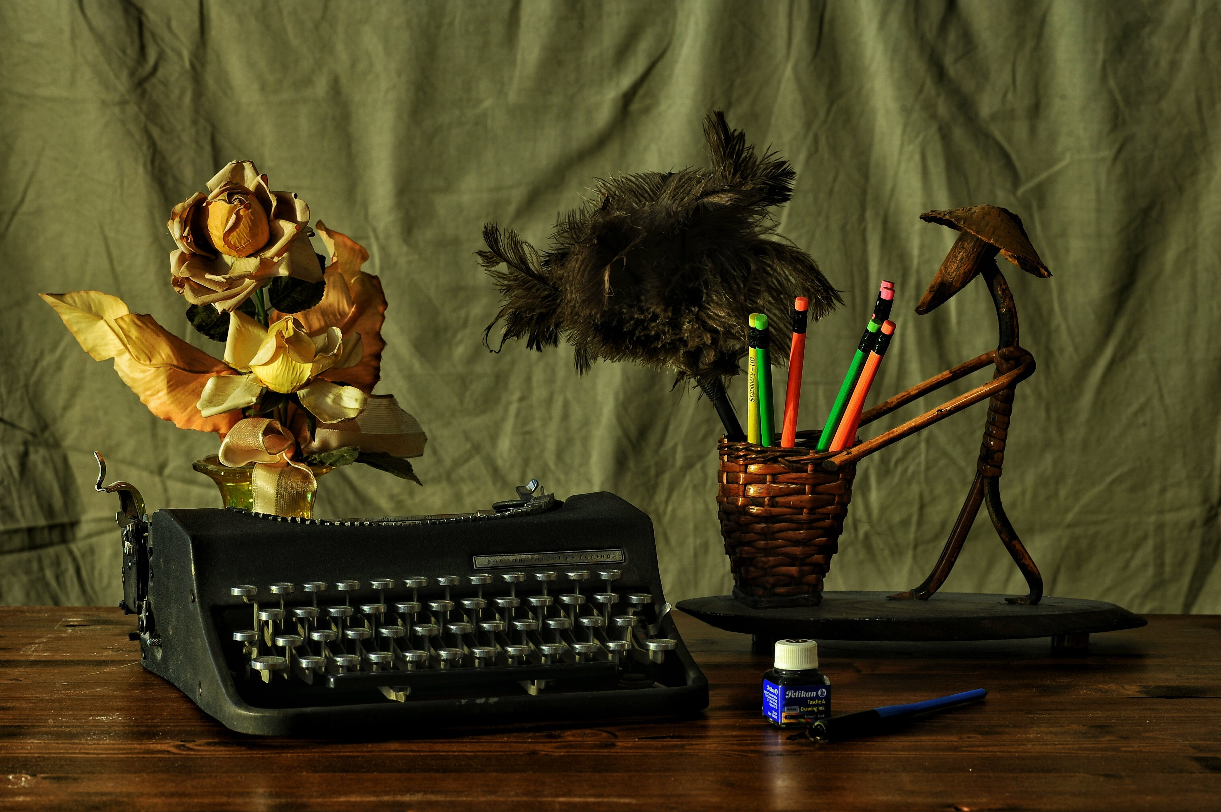 Black Typwriter Near Brown Wicker Pencil Cup