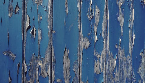 Gray Wall With Cracked Blue Paint