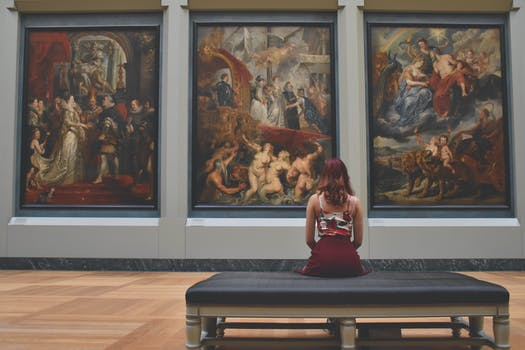 A person looking at art