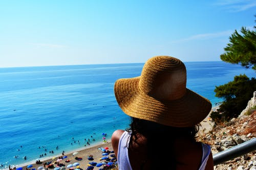 Free stock photo of beach, beach hat, by the sea