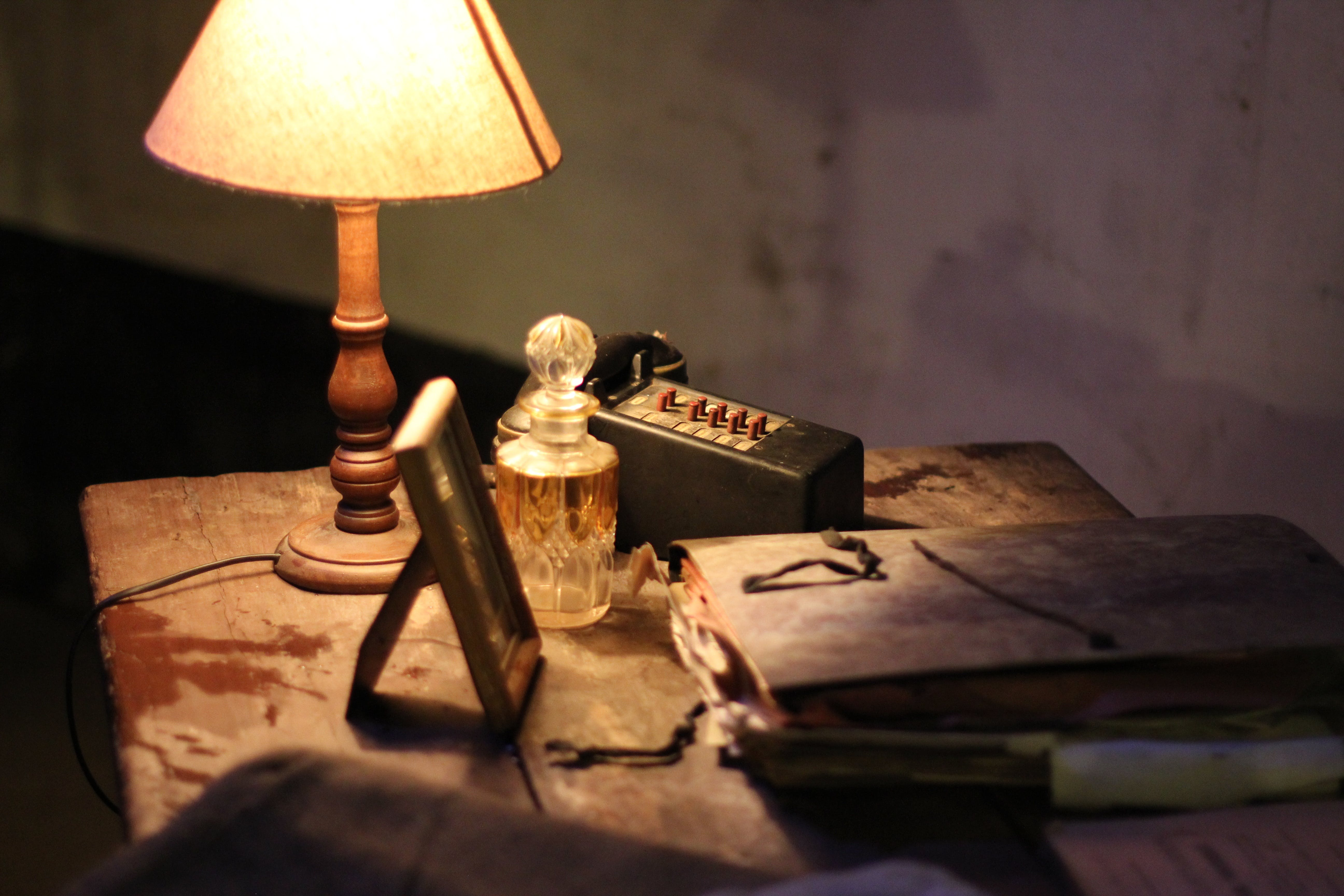 Black Book Beside Table Lamp