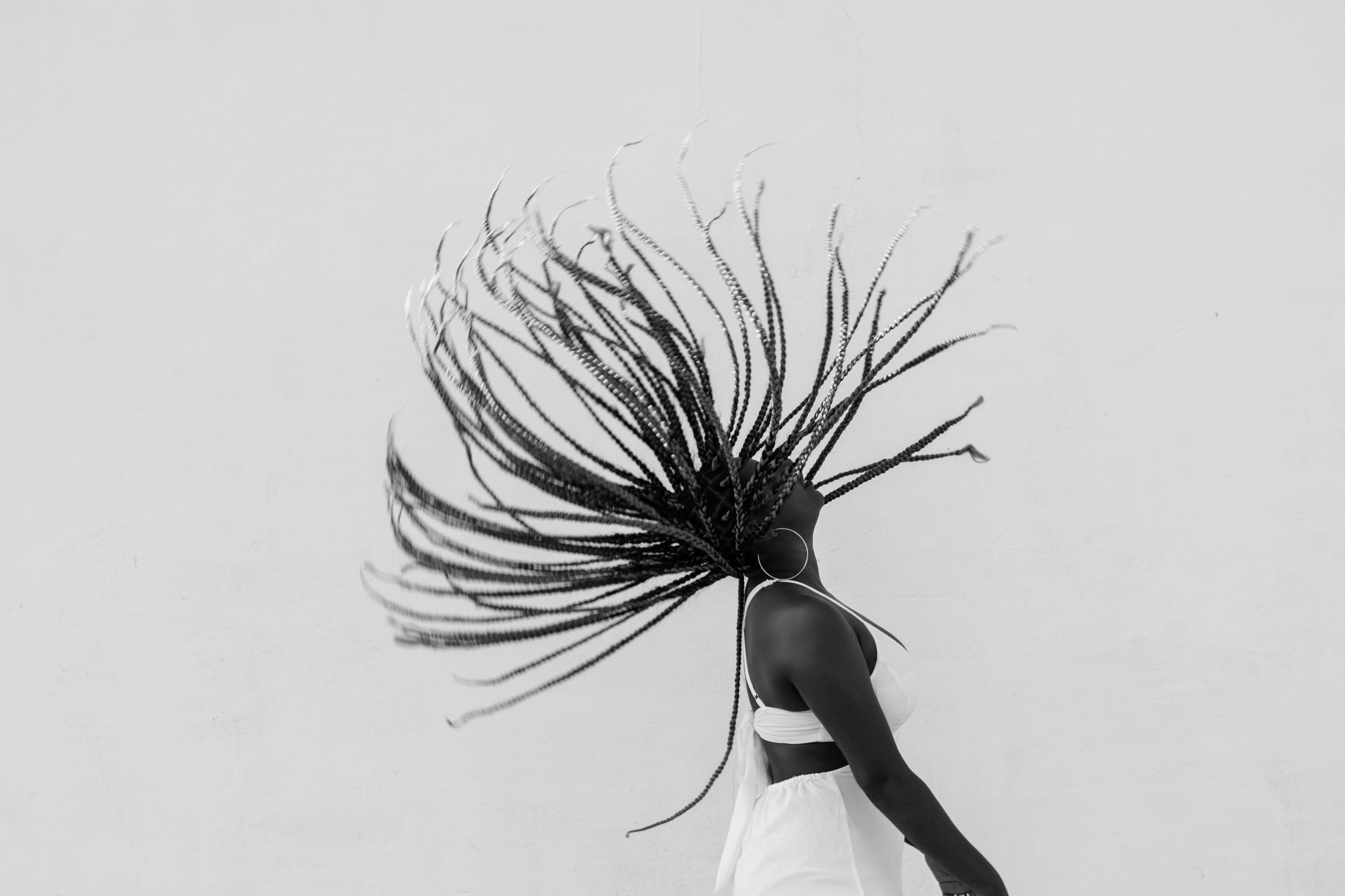 Woman In White Dress Flipping Hair
