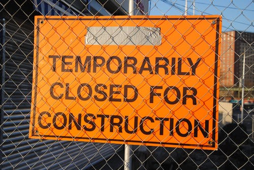Orange and Black Temporarily Closed for Construction Signage