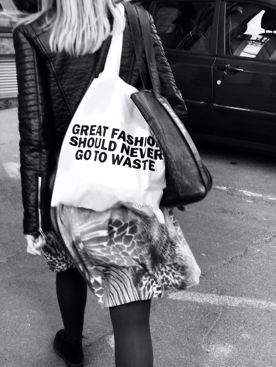 Grayscale Photography Of Woman Carrying A Bag