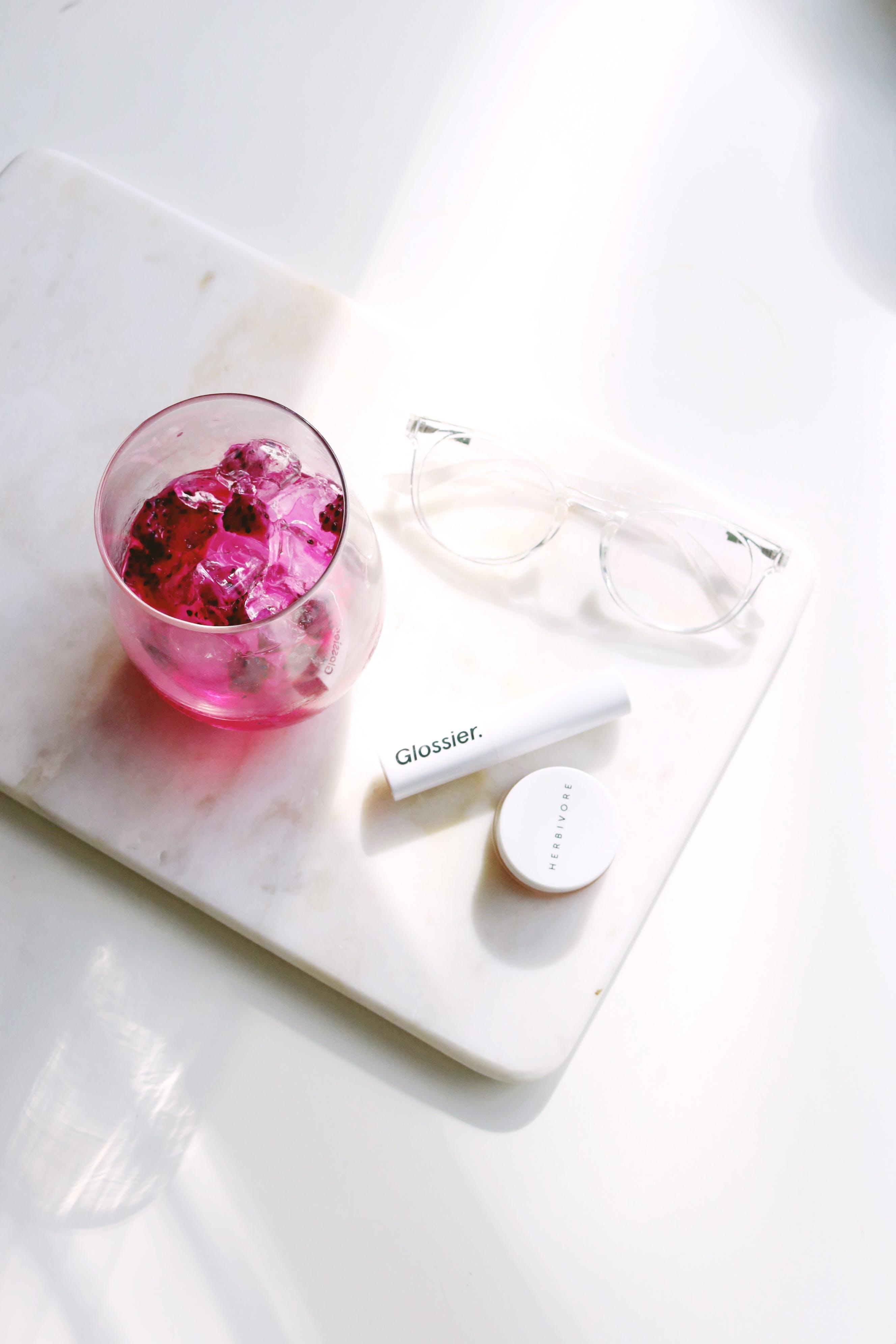 Cup Beside Eyeglasses