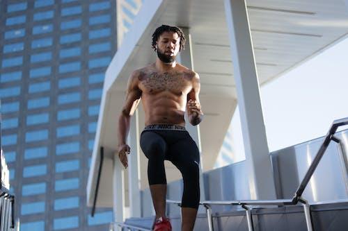 Topless Man In Black Pants Running