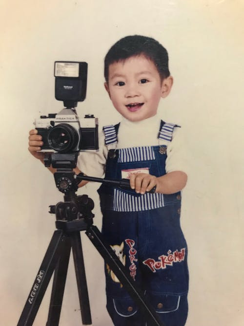 Baby Holding Camera