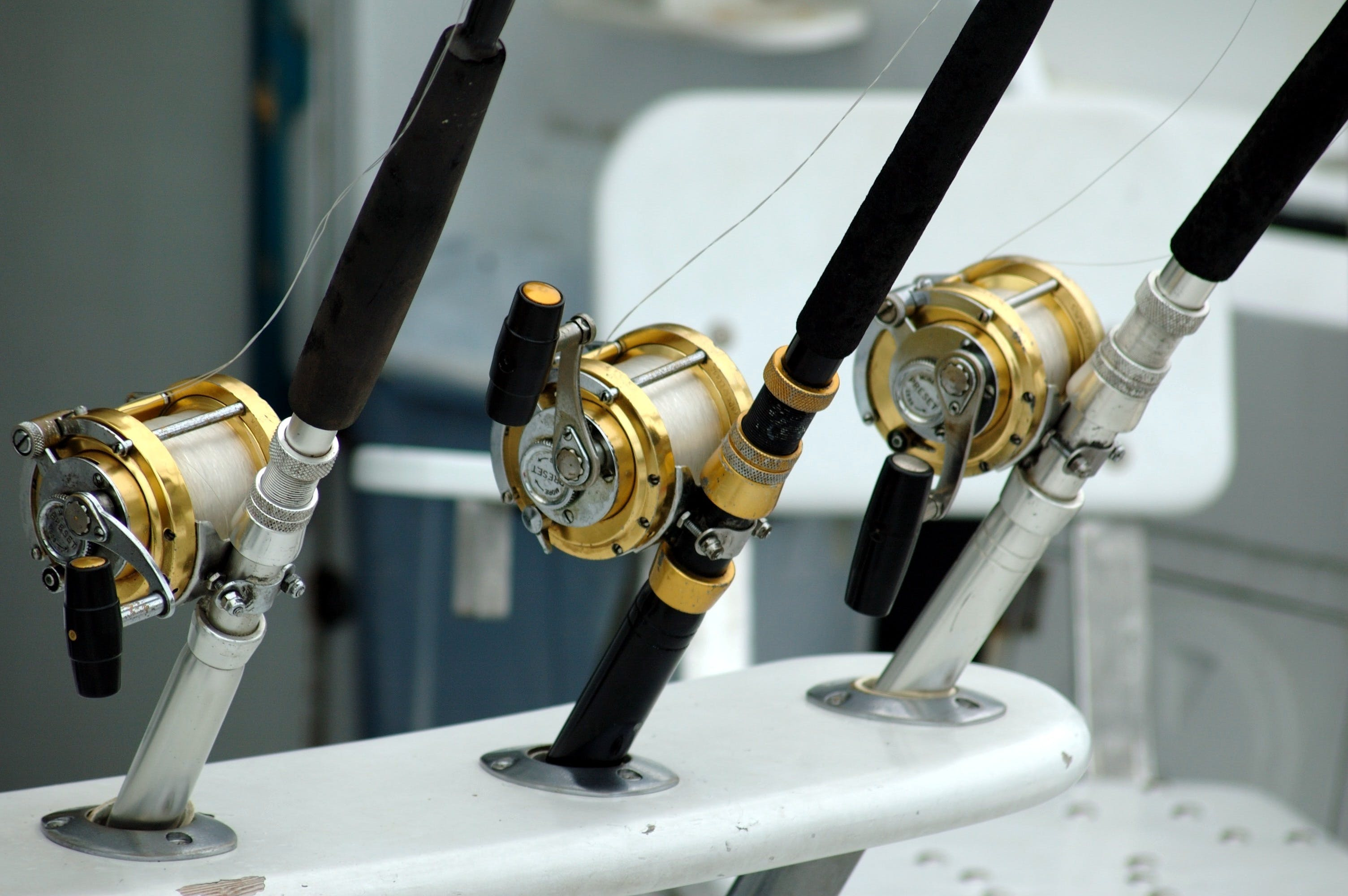 3 Lined Brass and Black Fishing Reel
