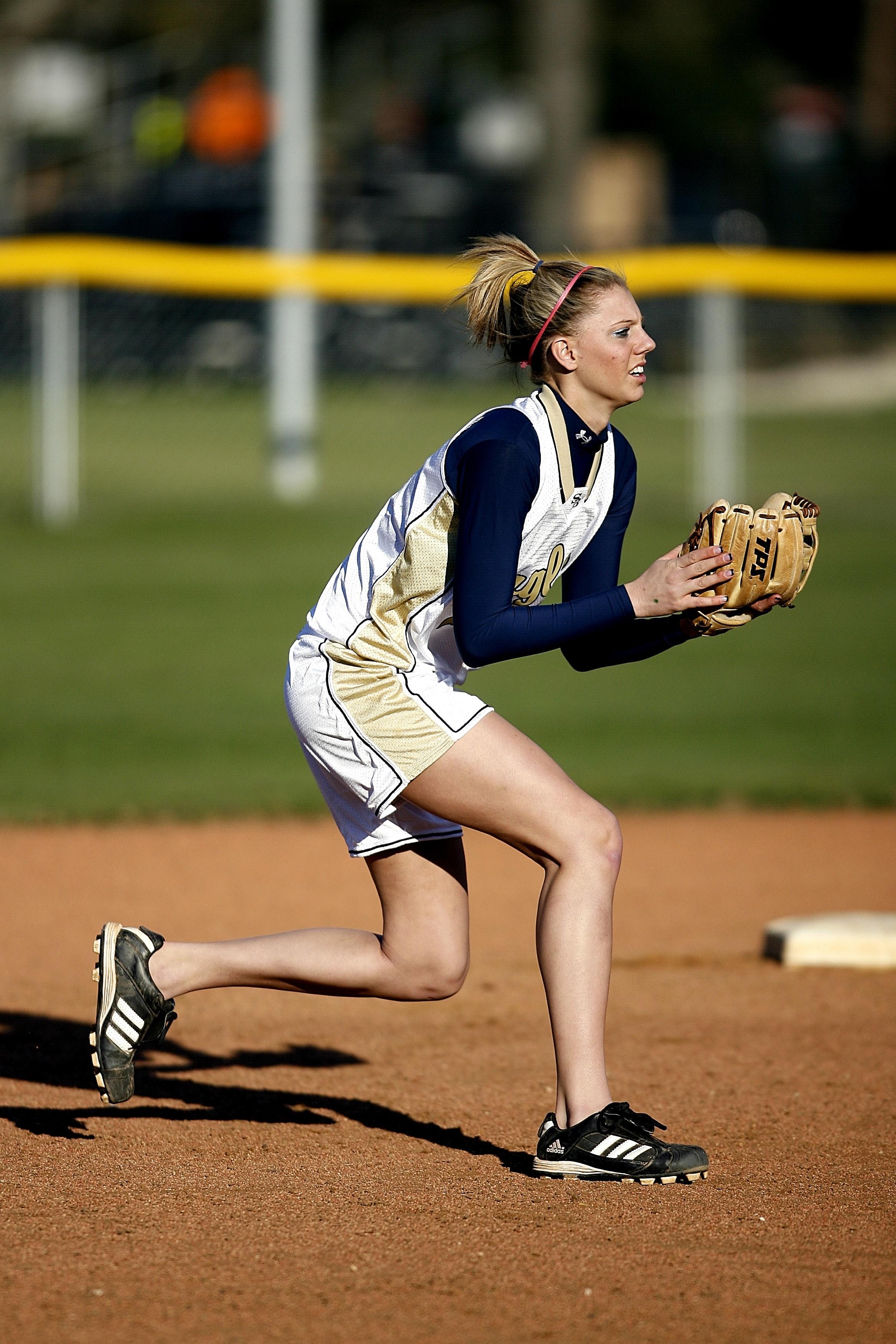 Woman In White Sleeveless Jersey Holding A Black Baseball -8473