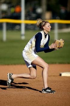 Woman Wearing Brown Leather Baseball Mitt