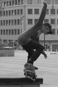 Boy Skateboarding Grayscale Photography