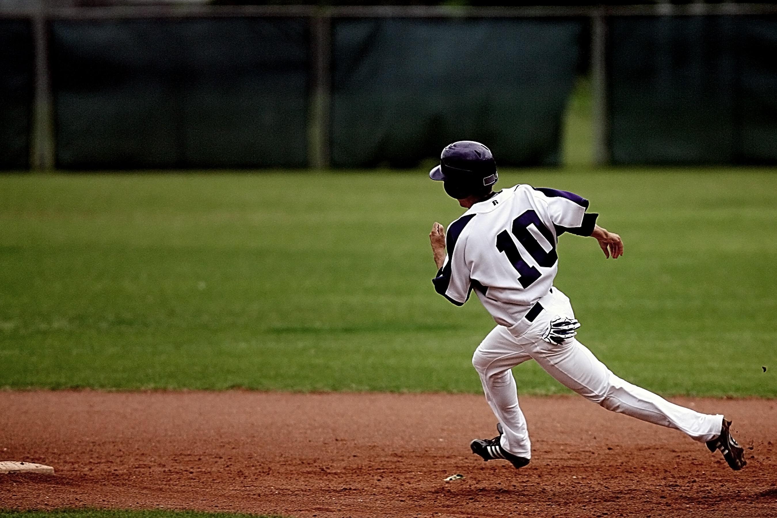 Baseball Player Running on Court