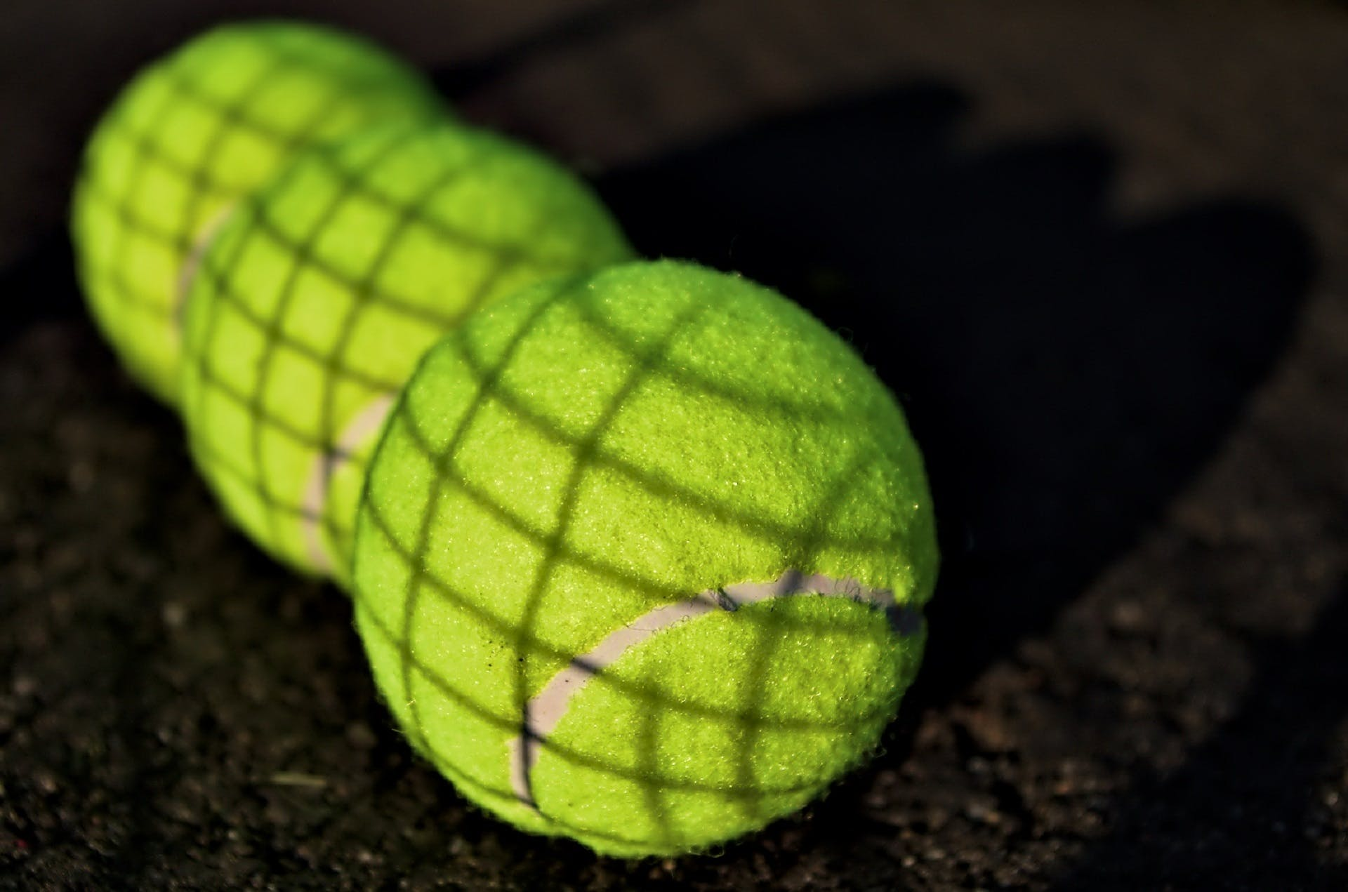 Three Green Tennis Balls