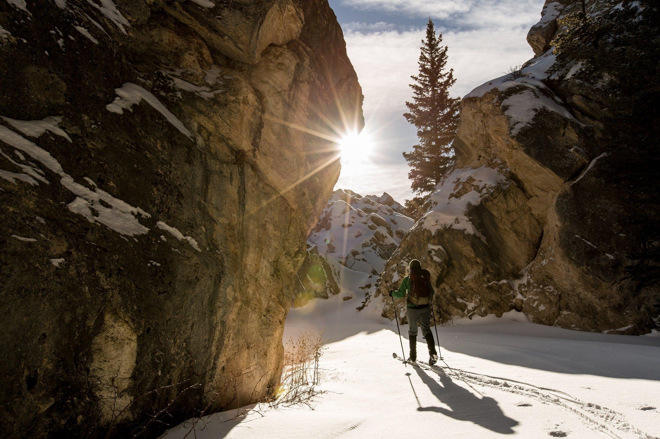 Man Hiking in Snowy Mountain