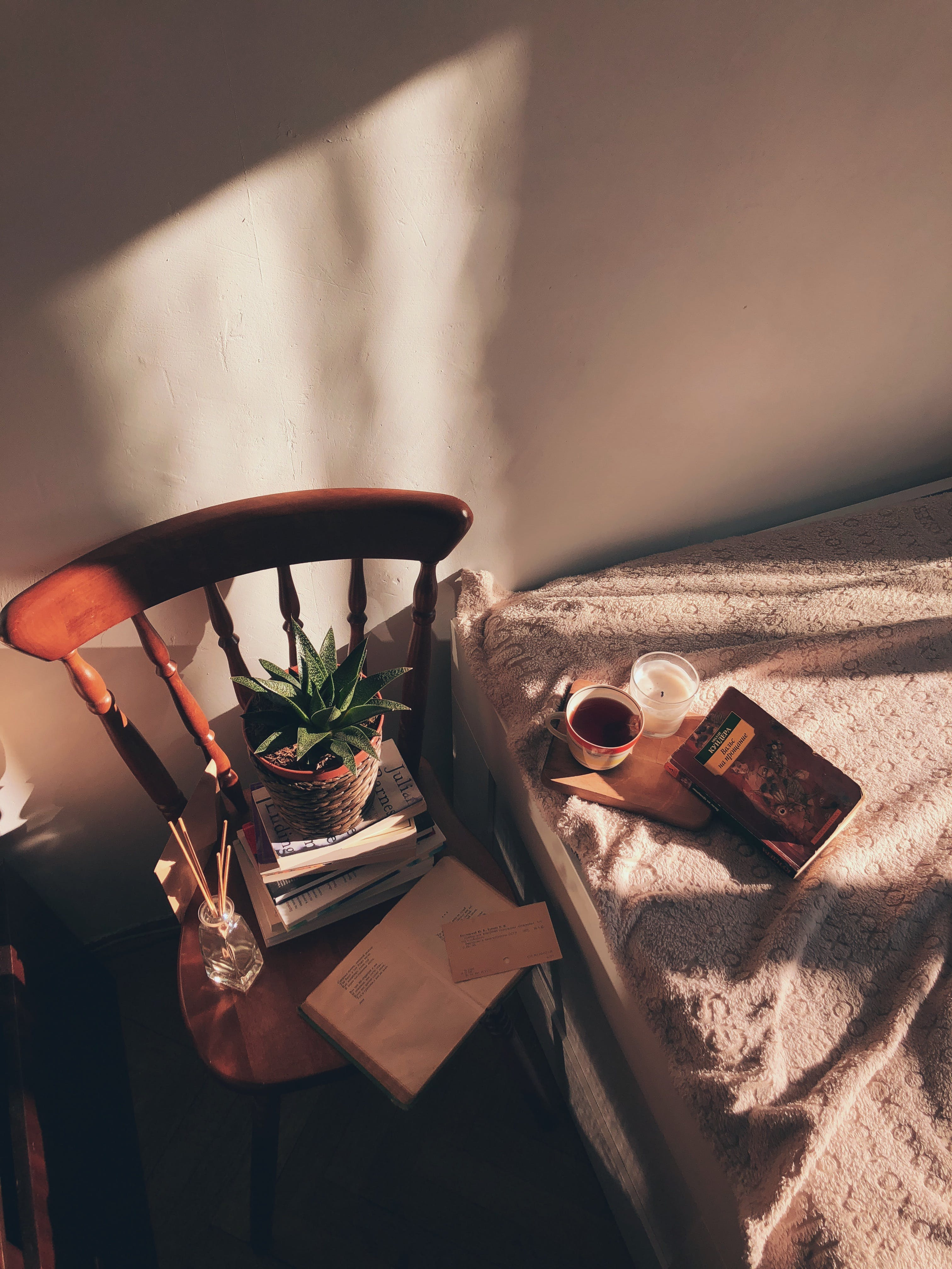Brown Wooden Chair Beside Bed