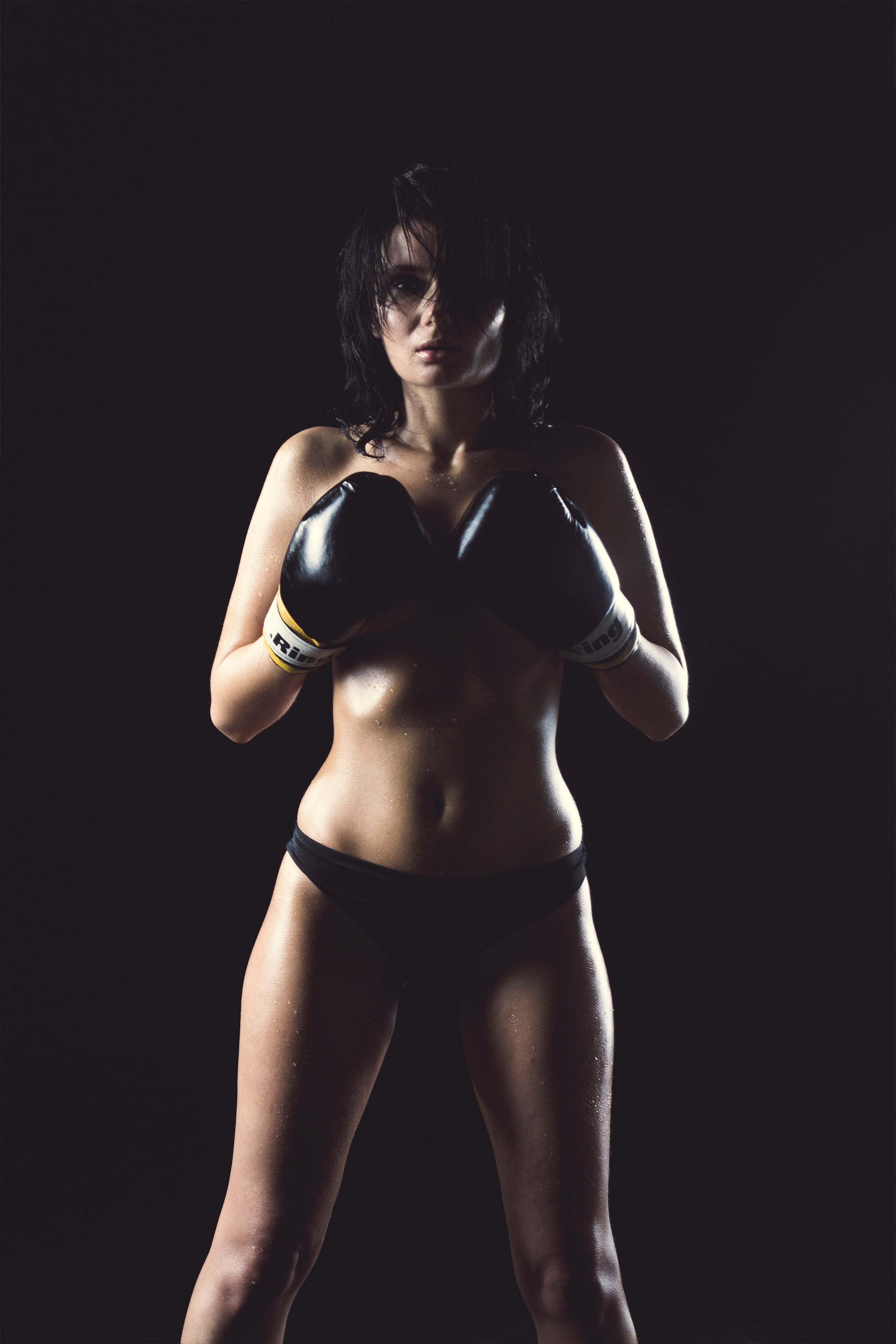 Woman in Black Panty Wearing Black Boxing Gloves Posing for Picture