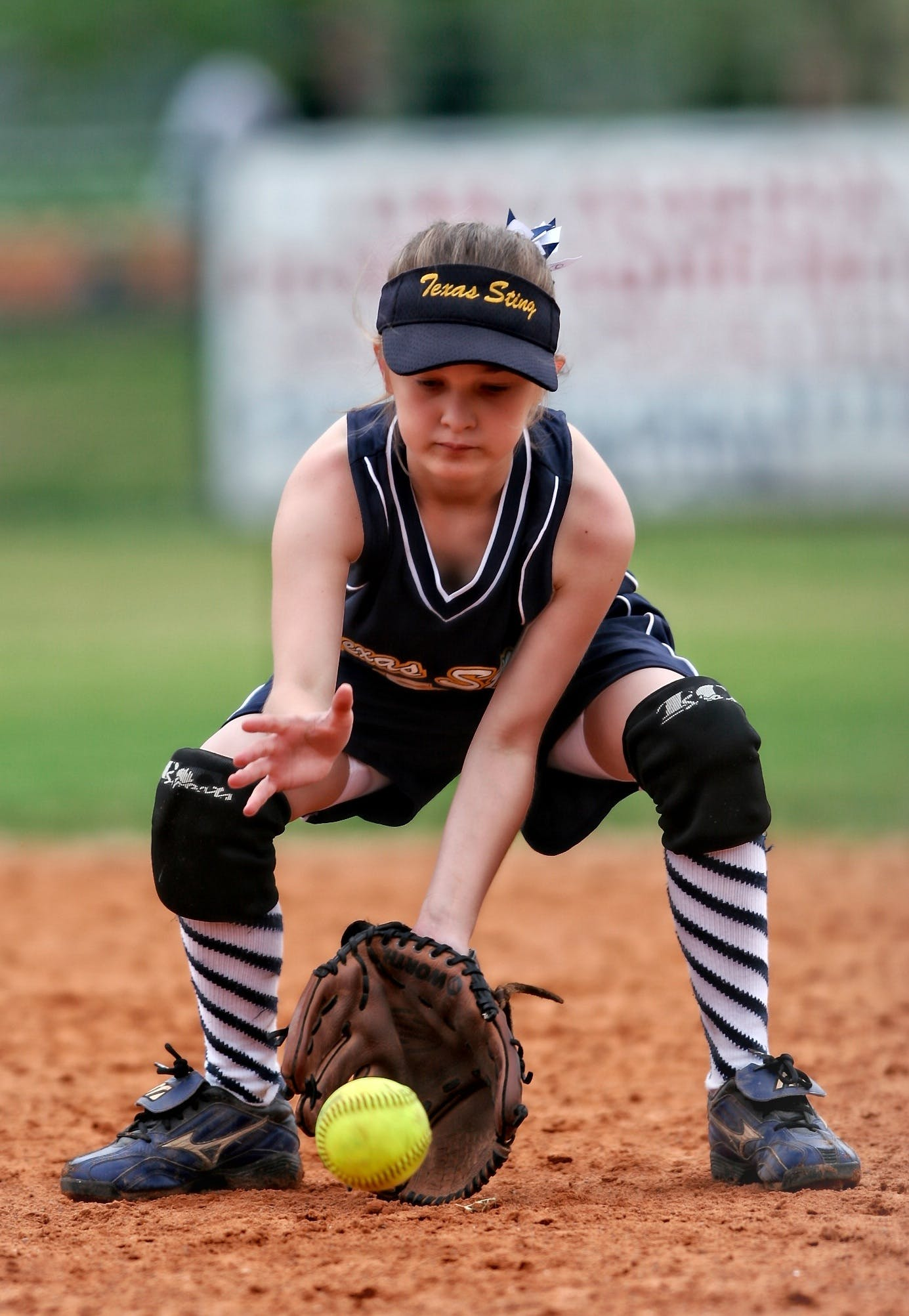 Softball Player About to Catch the Ball