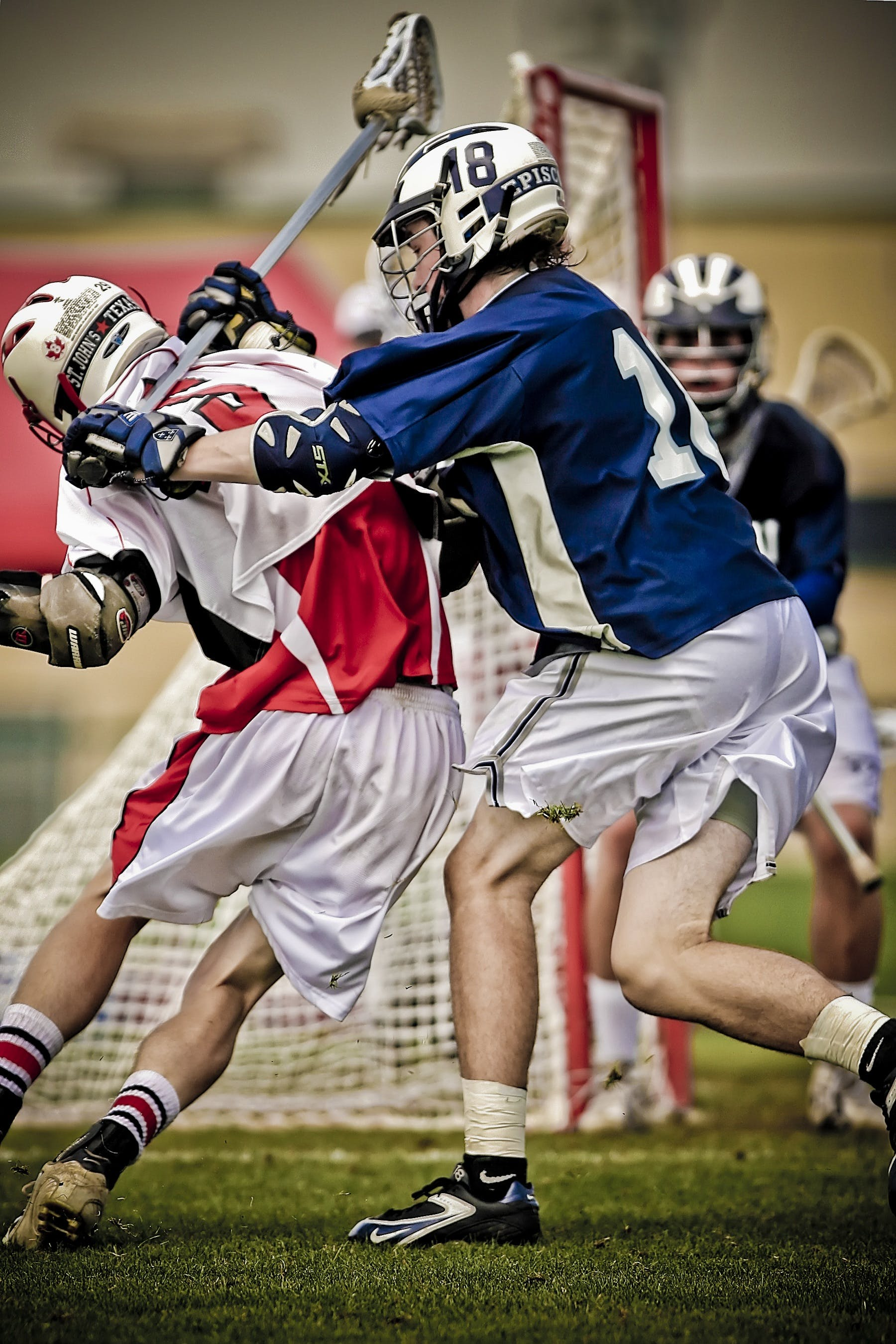 Lacross Player Battling on the Field