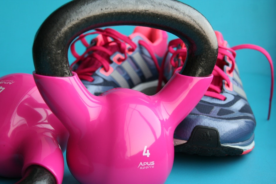 Kettle Bell Beside Adidas Pair of Shoes