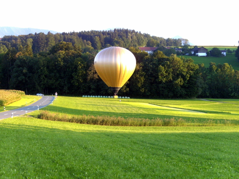 Beige Hot Air Balloon on Green Grass