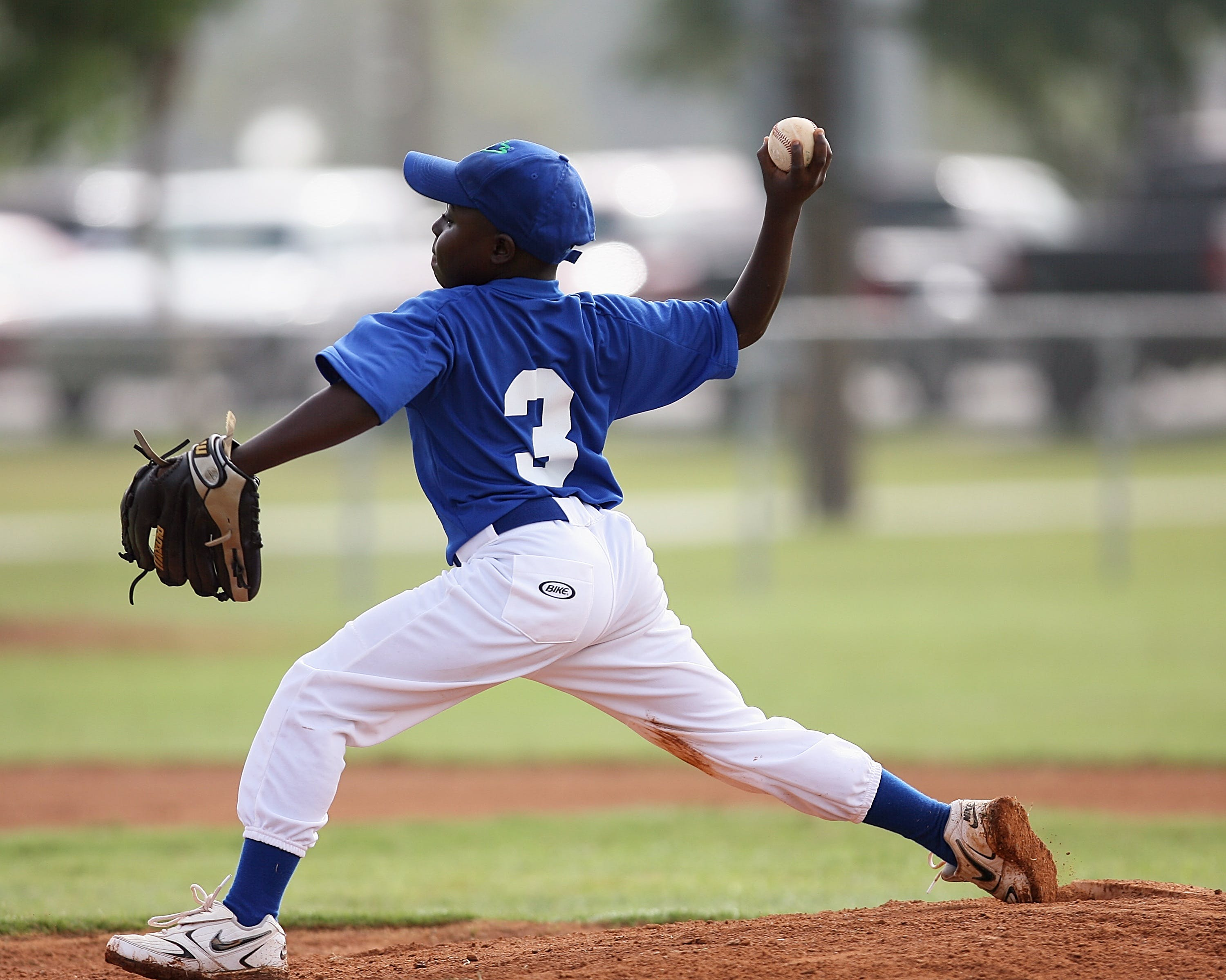 Boy Wearing Blue and White 3 Jersey About to Pitch a Baseball