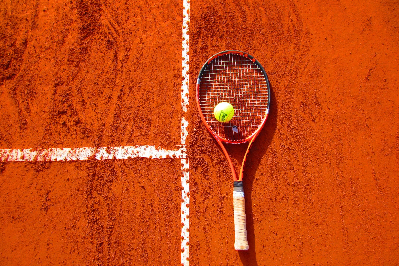 Tennis Ball On Tennis Racket On Floor Free Stock Photo