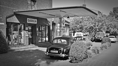 Two Cars Parked Near Gasolin Store